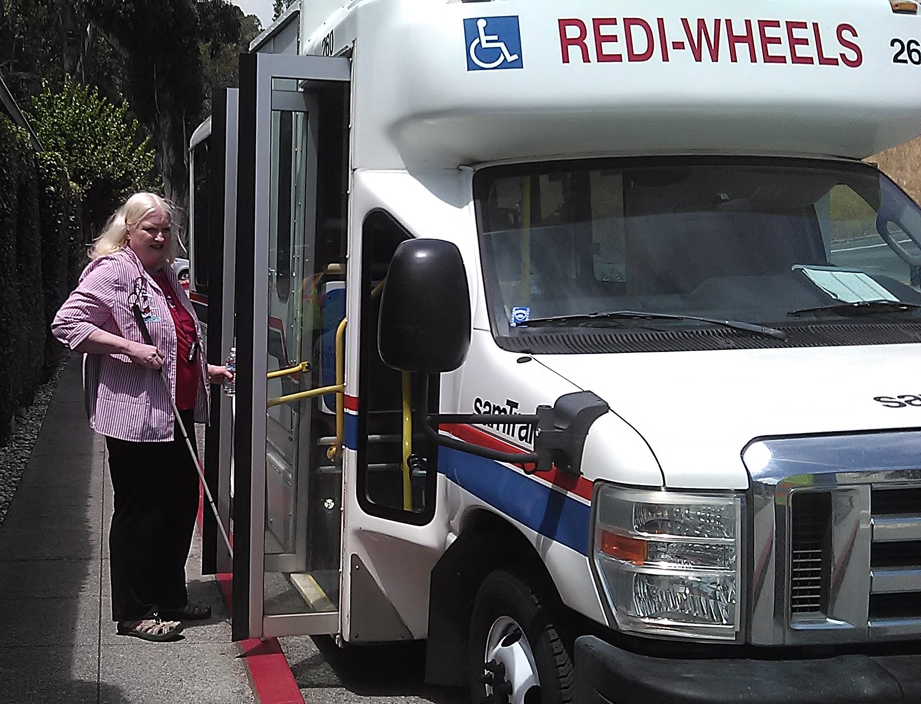 Woman boarding Redi-wheels vehicle